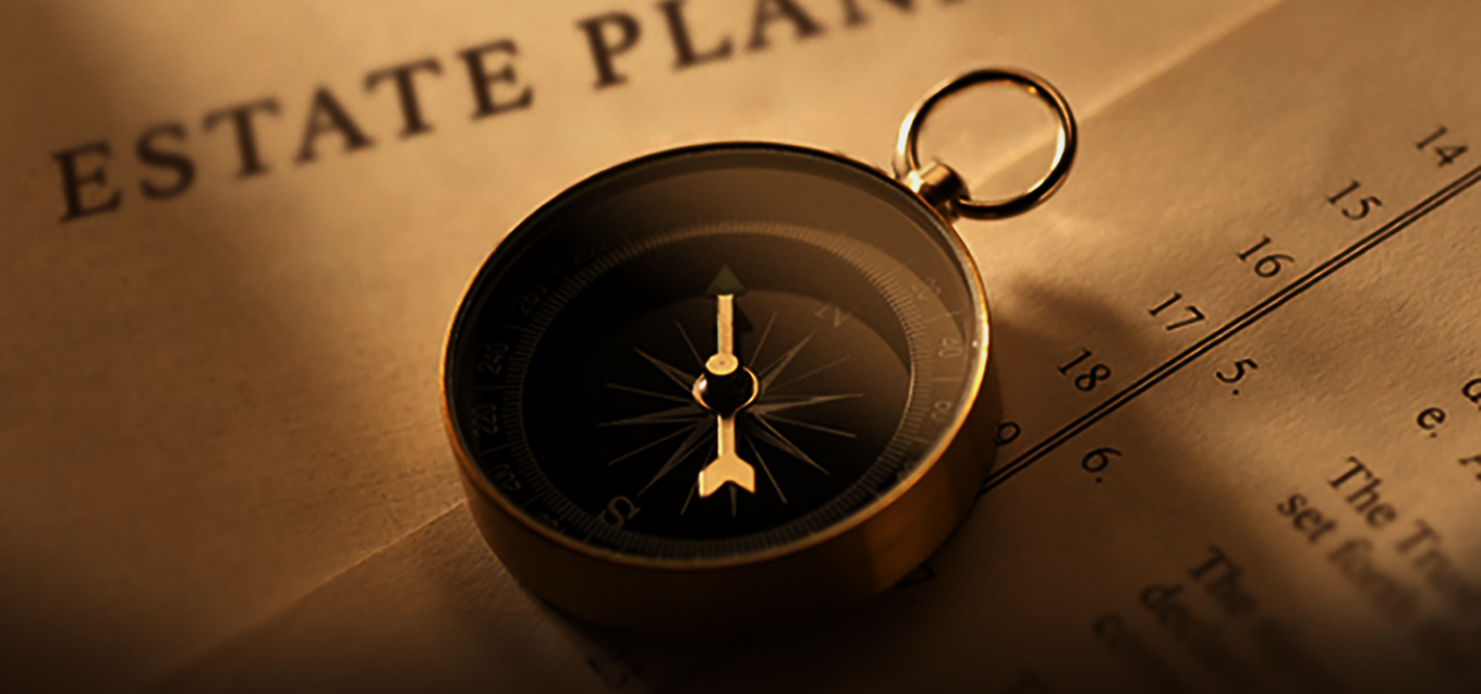 Photo of estate planning documents with a compass on top of papers.